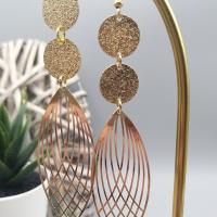 Grande boucle d'oreilles pendantes en laiton doré